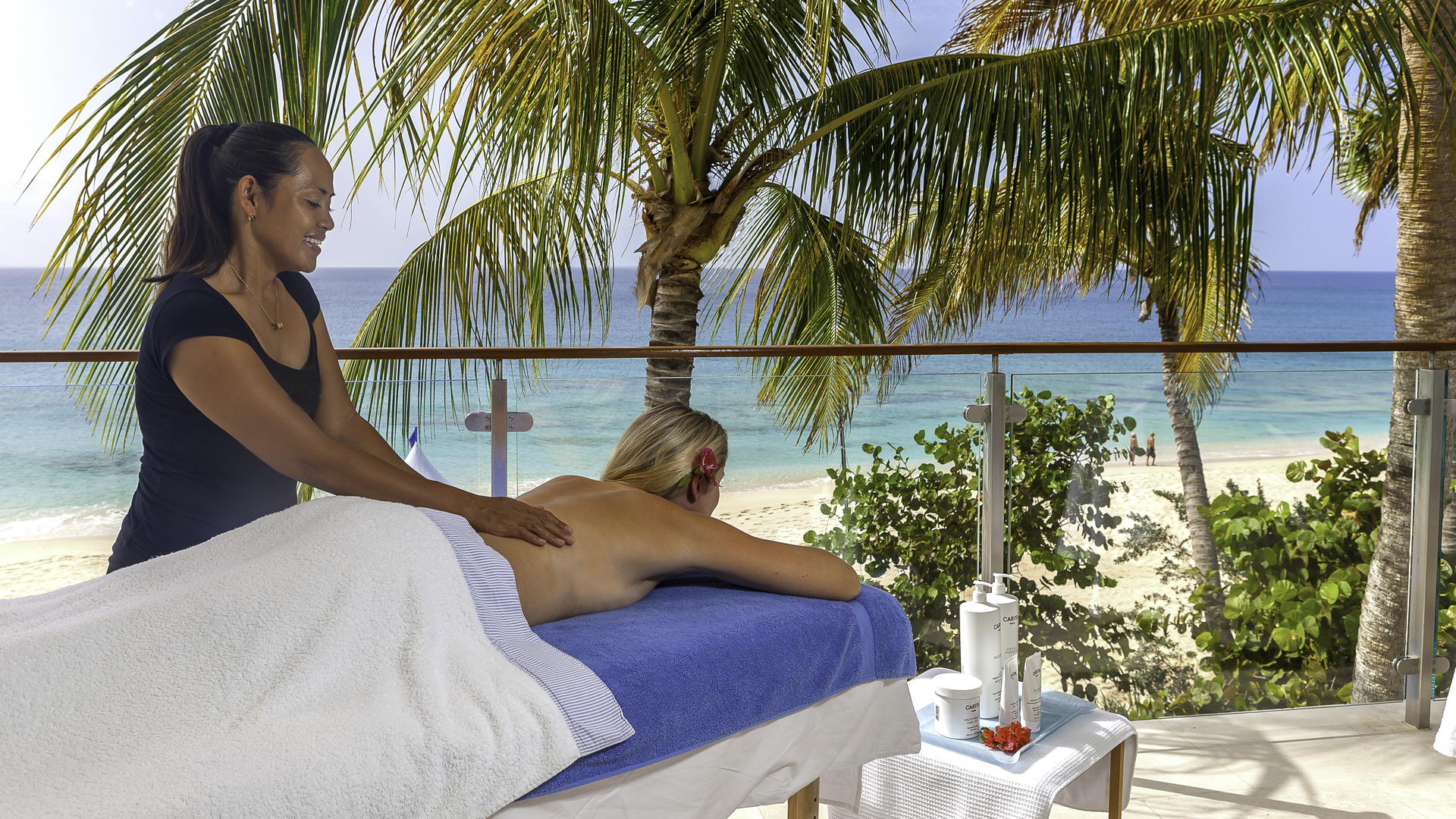 Massages are offered poolside and on the beach at Cerulean Villa